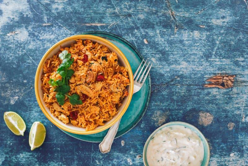 Hyderabadi chicken biryani on rustic table royalty free stock photos