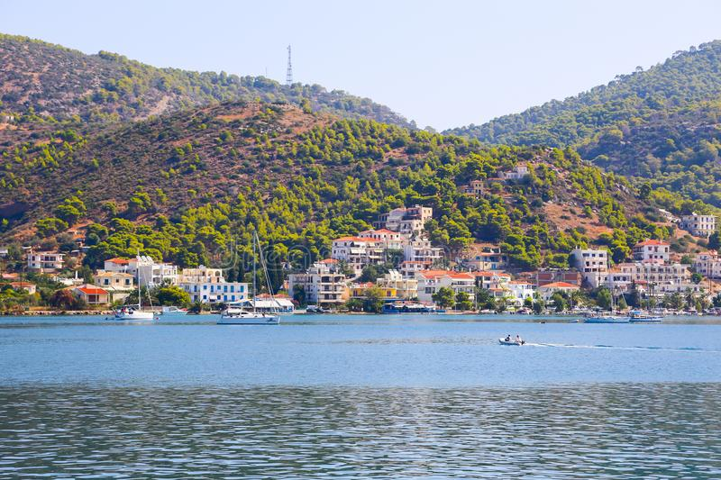 Hydra Island, Greece. JUNE 13 2015 Many tourists visiting and shopping at market street in old town royalty free stock photo