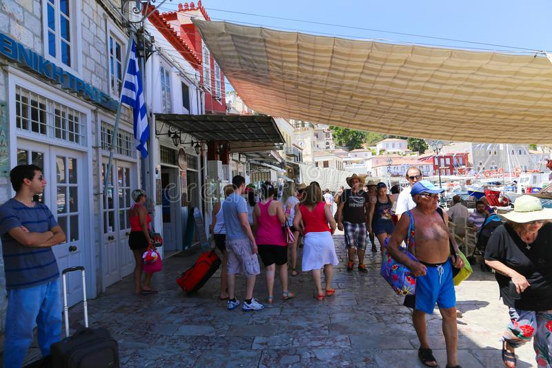 Tourists at Hydra Island, Greece. Hydra ISLAND, GREECE- JUNE 13 2015 Many tourists visiting and shopping at market street in old town royalty free stock images
