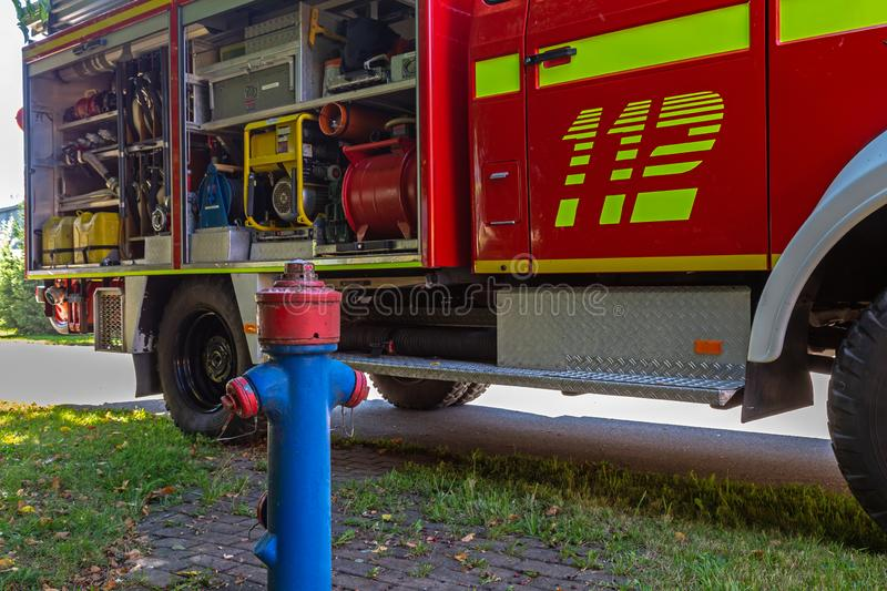 Hydrant in front of a german fire truck stock photography