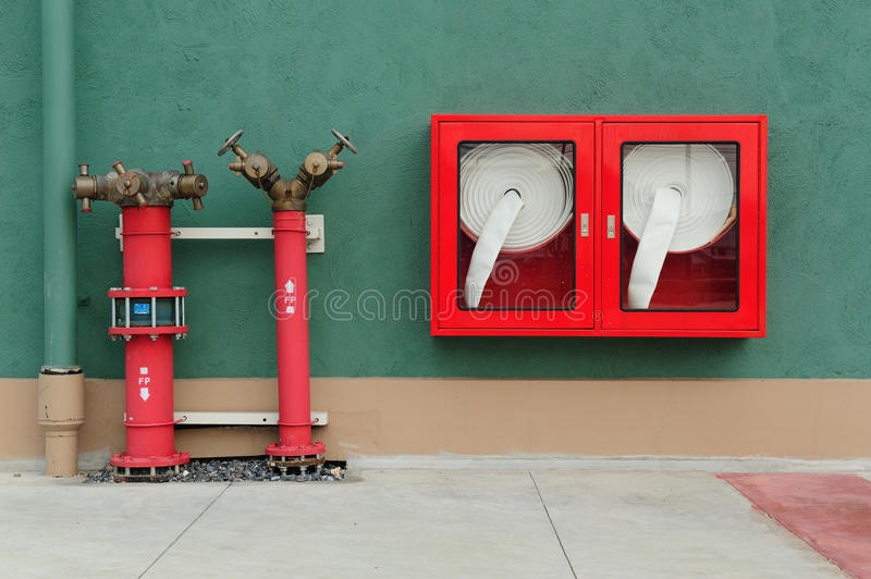 Hydrant with water hoses and fire extinguish stock photos