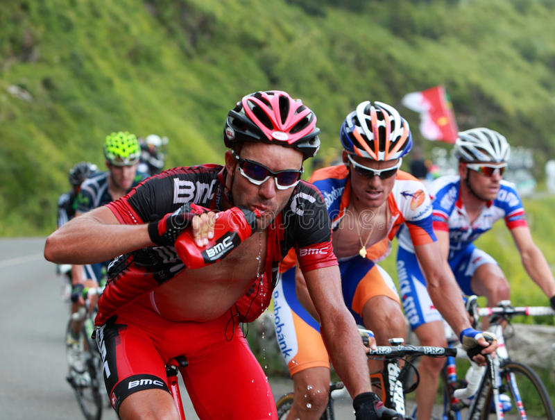 Hydration. Beost,France,July 15th 2011: The cyclist George Hincapie (BMC racing team ) drinking water while he climbs the category H mountain pass Abisque in the royalty free stock image