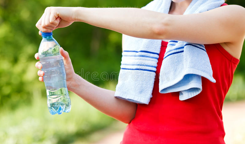 Hydration. Do not forget to hydrate yourself during workout stock images