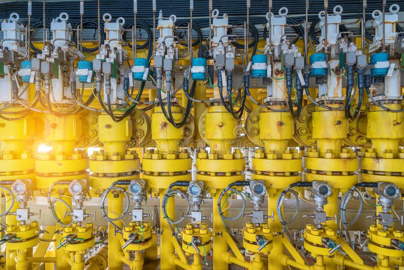 Hydraulic choke or throttle valves at offshore oil and gas wellhead remote platform royalty free stock photography