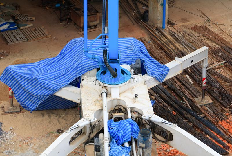 Hydraulic crane leg On the ground In the construction area top view stock photo