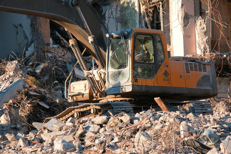 Hydraulic excavator building dismantling royalty free stock image