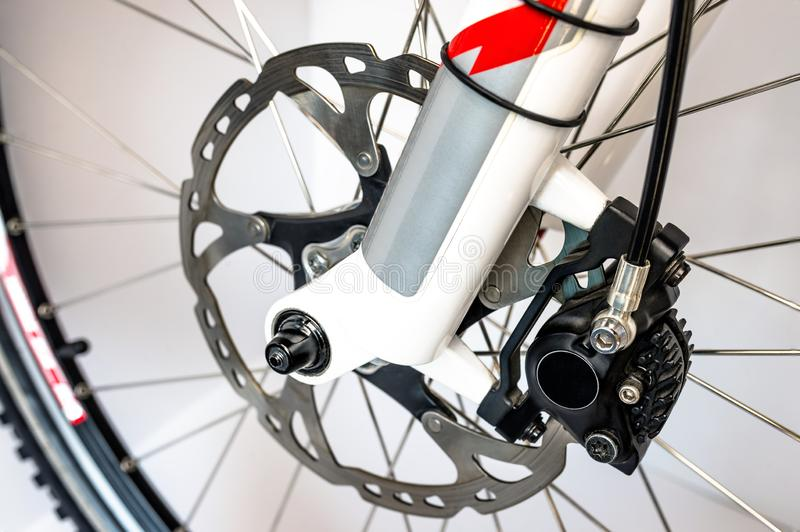Hydraulic front disc brake on mountain bike. Isolated on a white background. High resolution, full frame. Hydraulic front disc brake on mountain bike. Isolated royalty free stock image