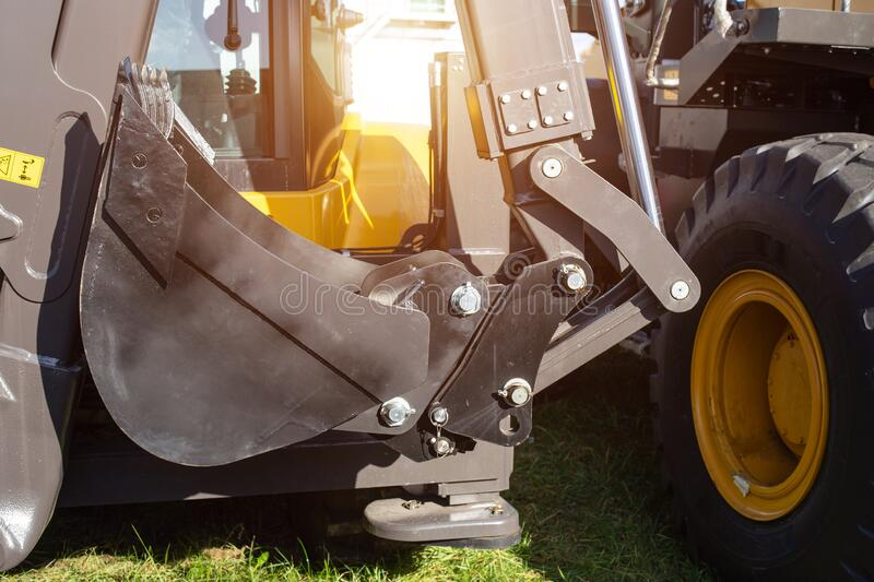 Hydraulic mechanism on construction equipment for driving a bucket on an excavator, industry, background stock photos
