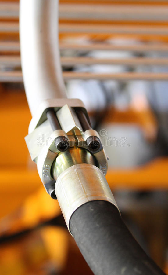 Hydraulic, pneumatic connection pipes. In cold metal cutting machine stock image
