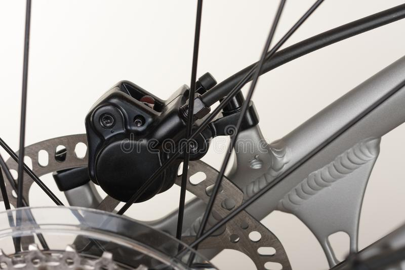 Hydraulic rear disc brake of mountain bike, close up view. stock photography