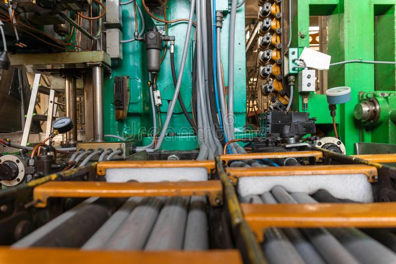 Hydraulic system of the machine, oil under pressure in hydraulic pipes, repair of industrial equipment control systems.  stock photos