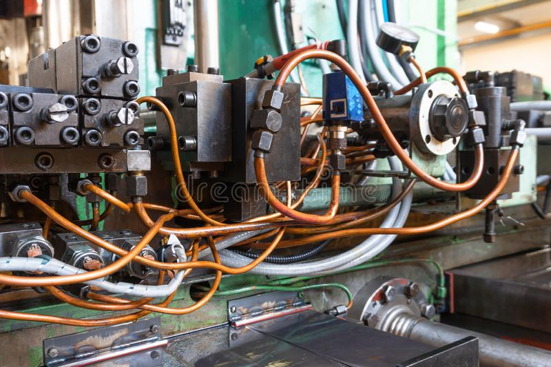 Hydraulic system of the machine, oil under pressure in hydraulic pipes, repair of industrial equipment control systems.  stock photography