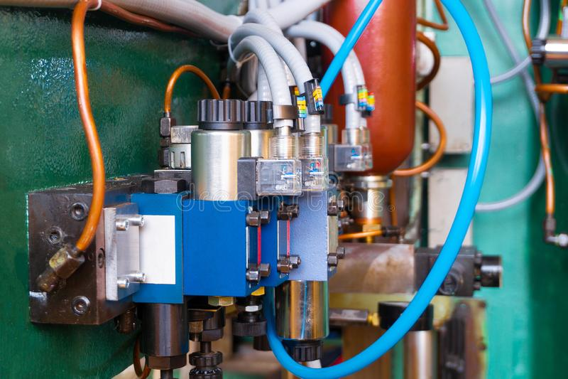 Hydraulic system of the machine, oil under pressure in hydraulic pipes, repair of industrial equipment control systems.  stock photo