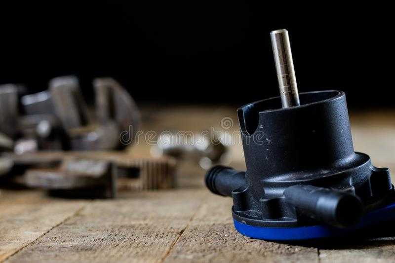 Hydraulics, tools for plumber on wooden table. Workshop, table a. Nd tools - adjustable spanner, connectors, keys. Black background stock photos