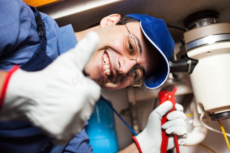 Hydraulik przy pracą zdjęcia stock