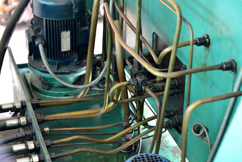 Hydraulikoljastation på maskinhjälpmedlet på industriell utrustning Smörjningssystem med olja under tryck arkivbild