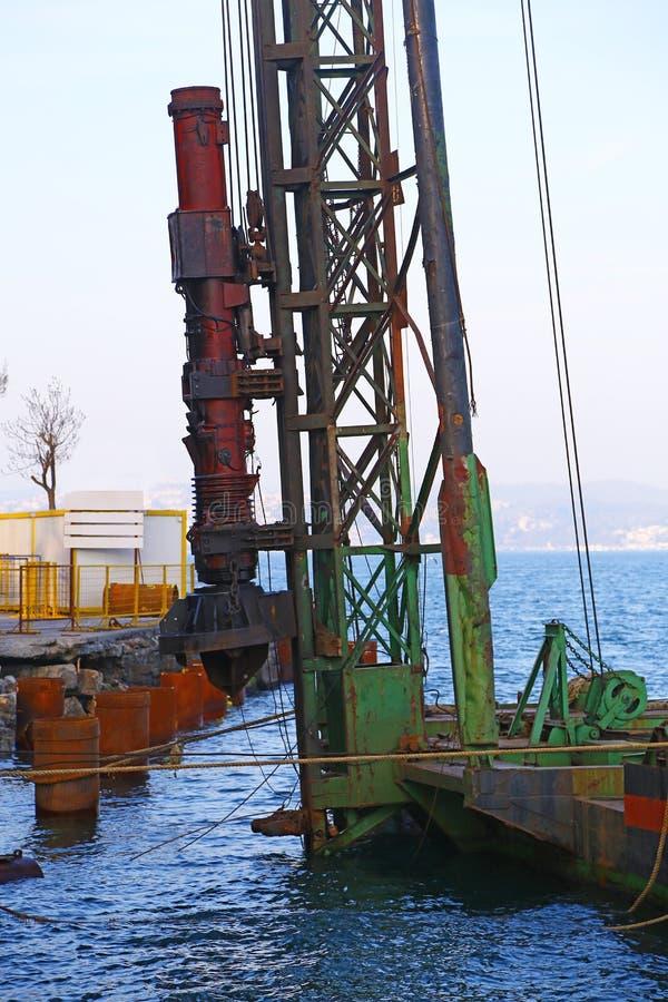 Hydraulische heimachinemachine stock afbeeldingen