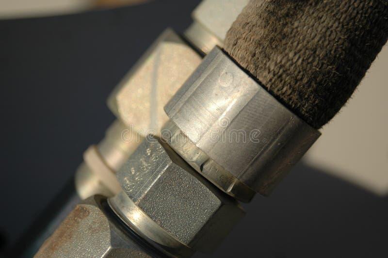 Hydraulische lijnkoppeling op zware machines stock afbeeldingen