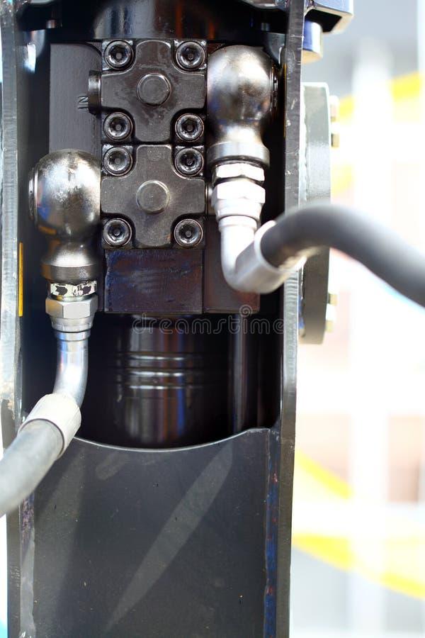 Hydraulische verbindingen van een machines industrieel detail stock foto's