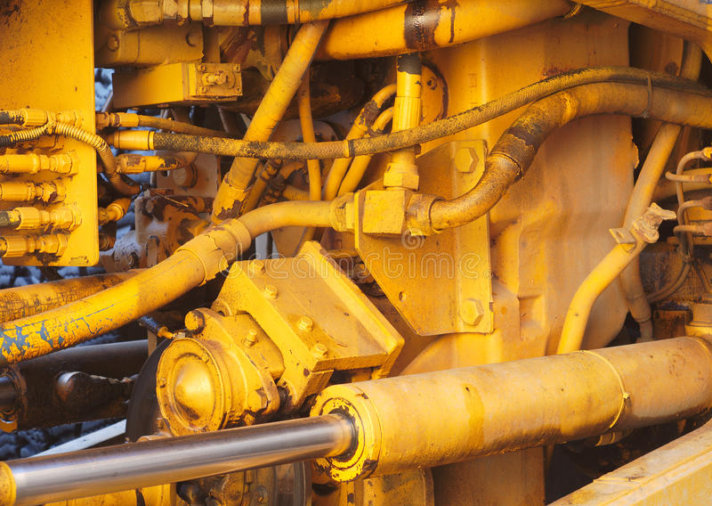 Hydraulische Zugmaschinenahaufnahme des gelben Bewegungsmaschinenmaschinenbaggers lizenzfreies stockfoto