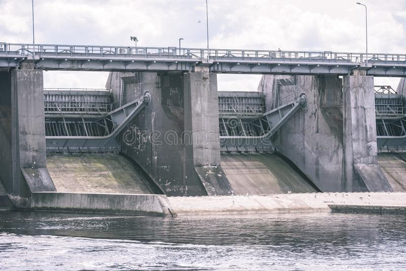 hydro electric power station gates for water - vintage film effect stock photo