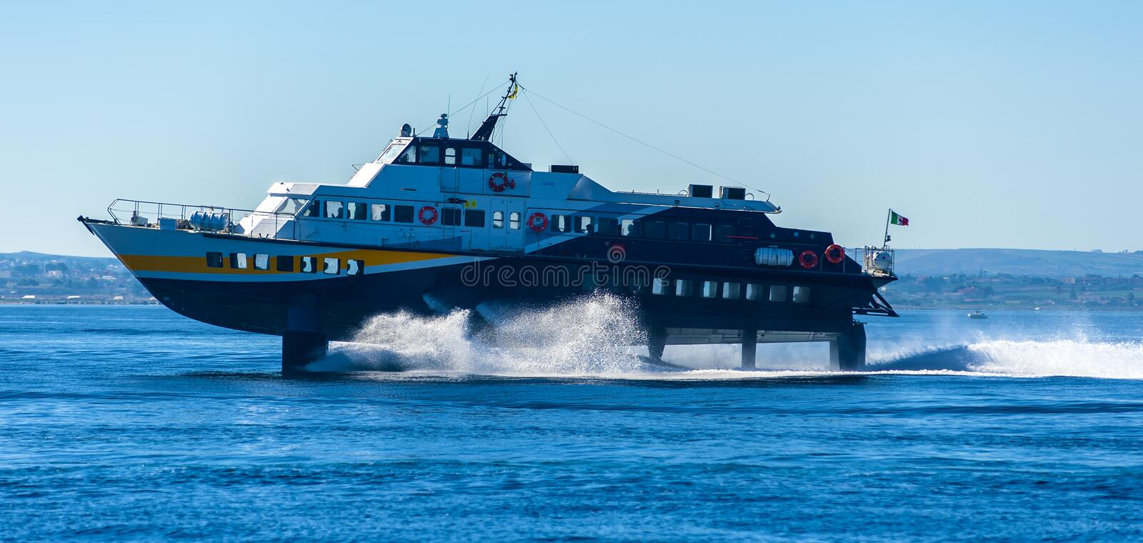 Hydrofoil boat runs at full speed. On the sea waves royalty free stock photography