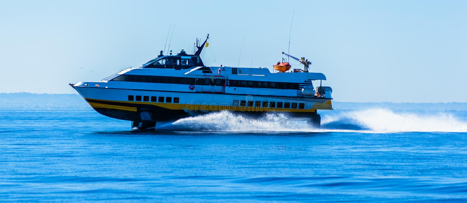 Hydrofoil boat runs at full speed. On the sea waves royalty free stock photos
