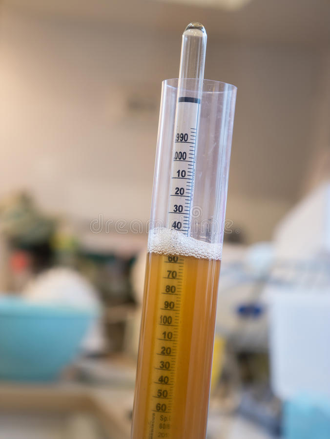 Hydrometer used to measure the specific gravity of wine and beer. Close up Hydrometer used to measure the specific gravity of wine and beer royalty free stock photo