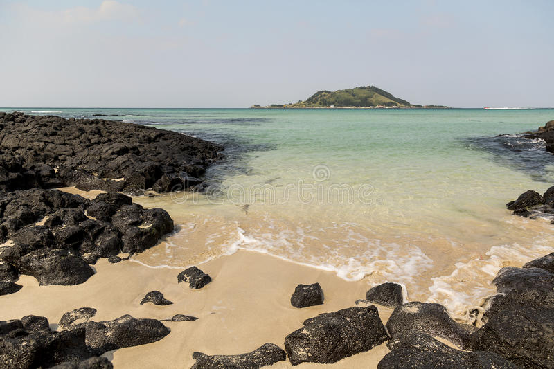 Hyeopjae beach in Jeju Island. Rocky and sandy beach in jeju island stock photo