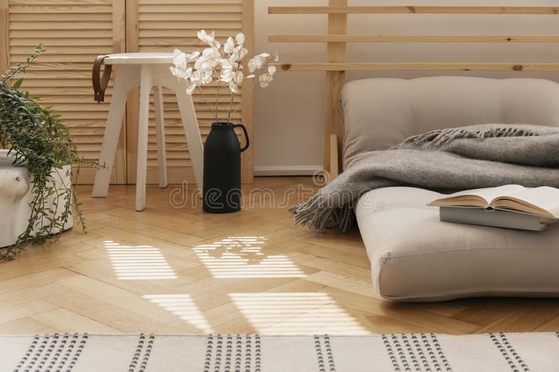 Hygge bedroom with scandinavian futon as a bed royalty free stock images