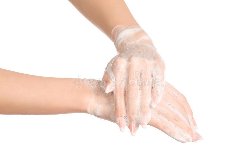 Hygiene and health protection topic: a woman's hand in soapsuds isolated on white background in studio. Hygiene and health protection topic: a woman's hand in stock image
