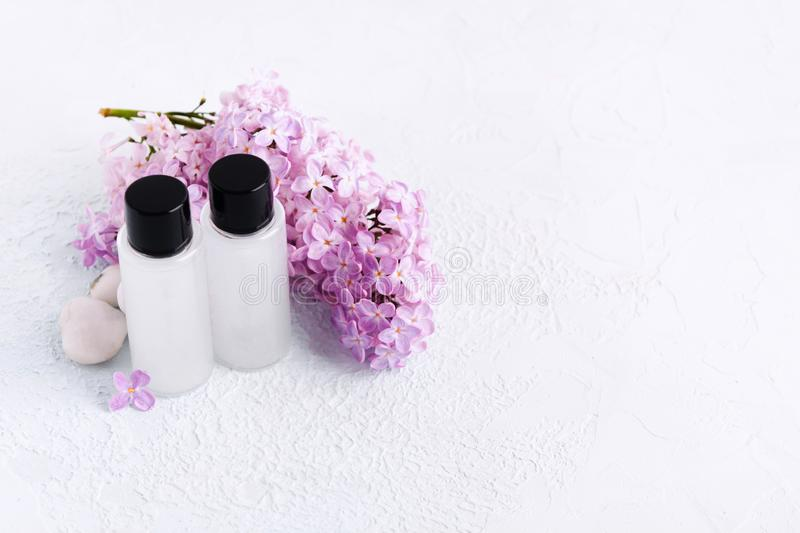 Hygiene products. Conditioner and shampoo for hair. Mockup with cosmetics. Copy space. Natural lilac. Soft focus stock image