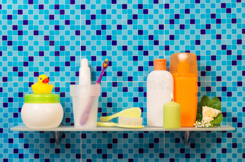 Hygiene products on the shelf. In the bathroom royalty free stock photography