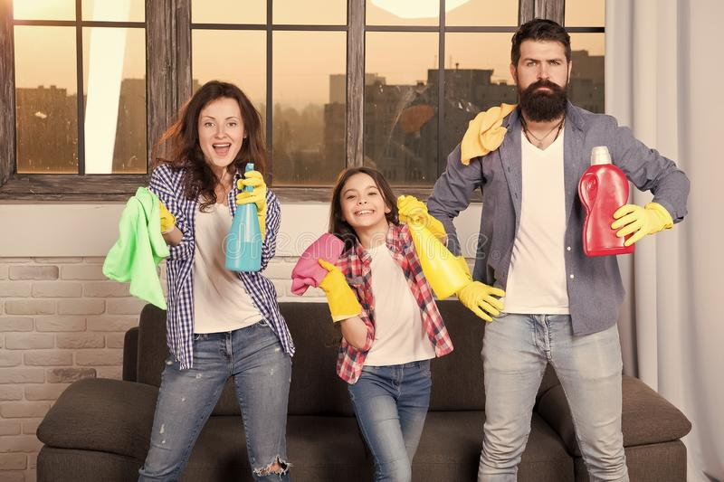 Hygiene. We will make your world spotless. Family clean house. Happy family hold cleaning products. Mother, father and. Daughter clean house. hygiene at home stock photos