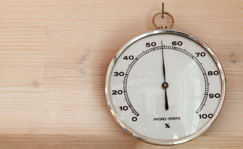 Hygrometer hanging on wooden wall, close-up royalty free stock photography