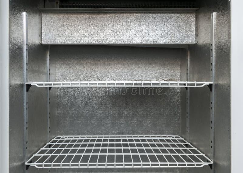 Hyllor i kylskåp royaltyfria bilder