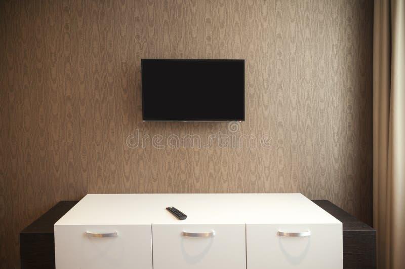 Hyllor och tv arkivfoton