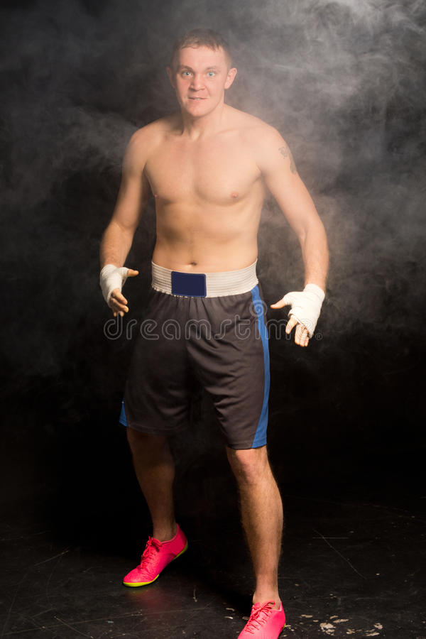 Hyped up young boxer ready for a fight royalty free stock photo