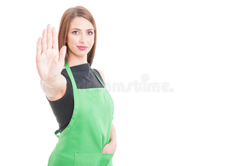Hypermarket employee doing restriction gesture. As stop right there concept isolated on white with advertising area royalty free stock photos