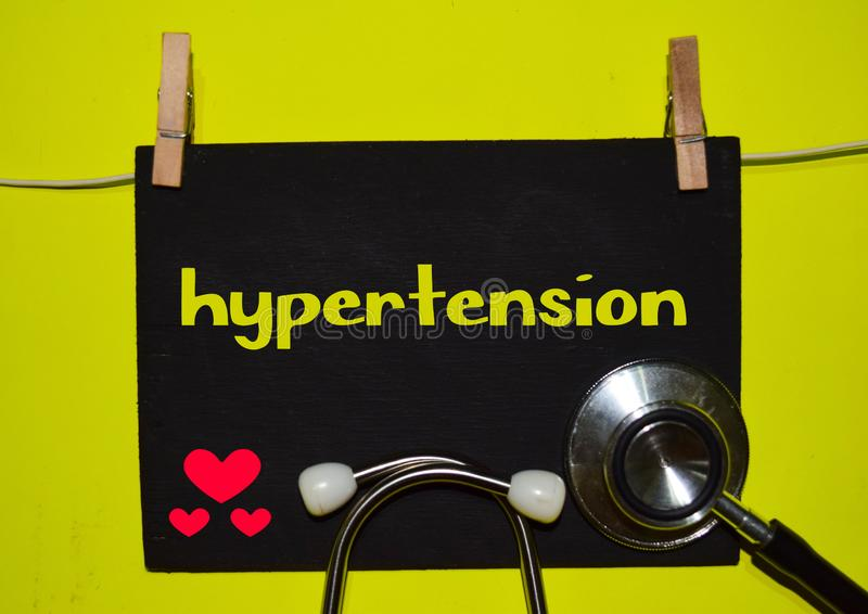 HYPERTENSION on top of yellow background royalty free stock photography