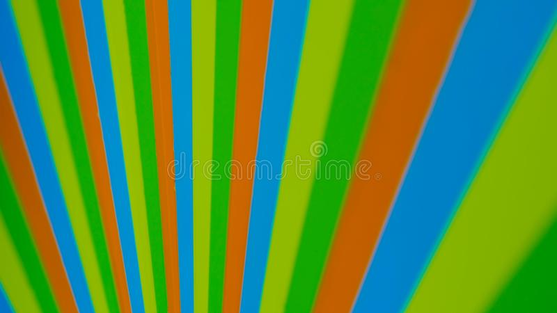 Hypnotic spinning pinwheel. Colourful strips. Optical distortion concept royalty free stock photo