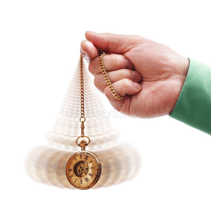 Hypnotiser la montre de poche image libre de droits