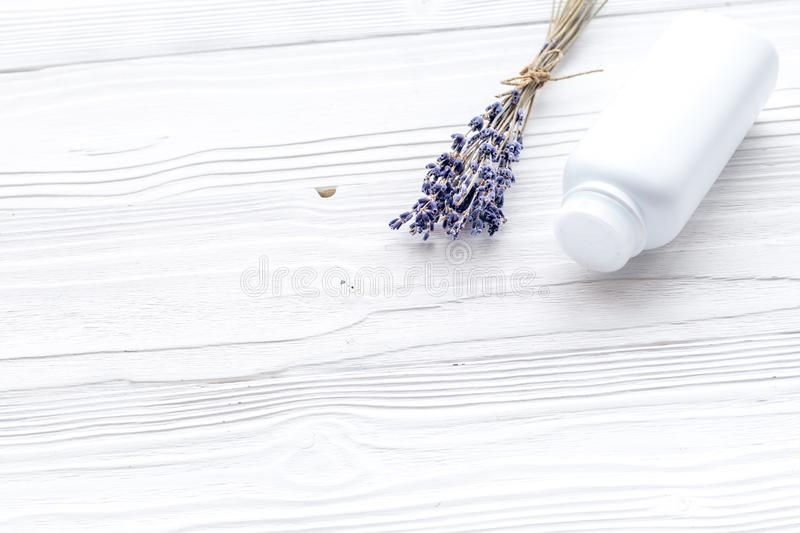 Hypoallergenic bath cosmetics for kids with lavender. Bottle on white wooden background copyspace stock photo