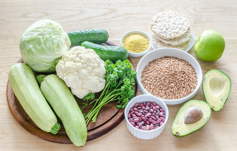 Hypoallergenic diet: products of different groups. On the wooden table royalty free stock photo
