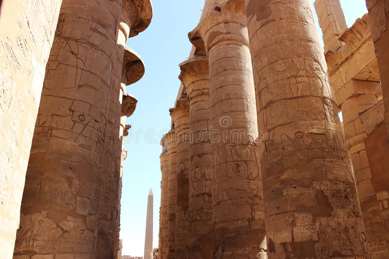 The hypostyle hall and the obelisk in the temple of Karnak stock images