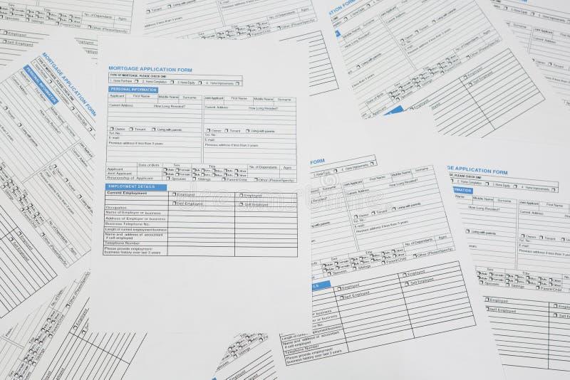 Hypotheekaanvraagformulieren stock afbeeldingen