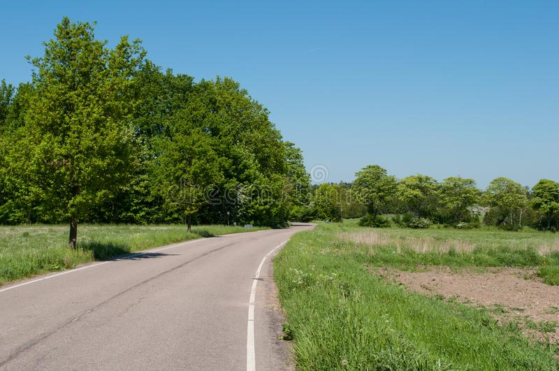 Hyrebakken road between Allerod and Farum in Denmark. On a spring day royalty free stock photography