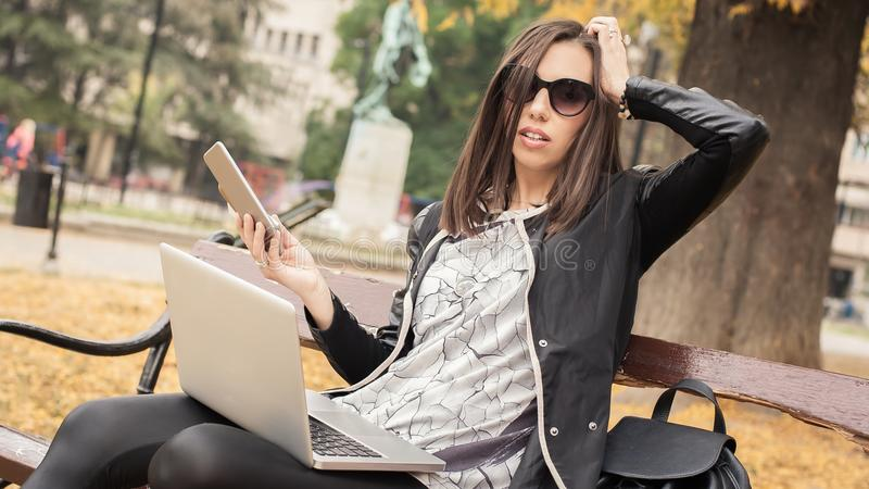 Hysterical girl with too many screens, mobils, tablets and laptops royalty free stock photos