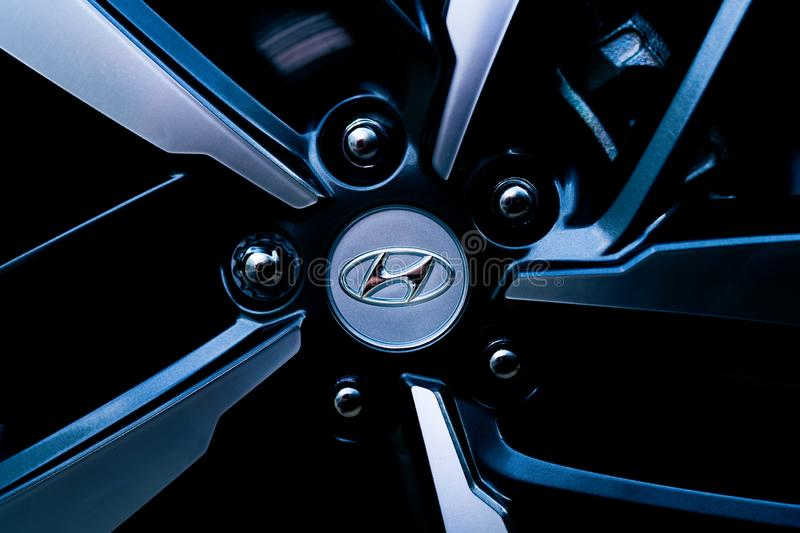 Hyundai Alloy Wheel. A Hyundai 2019 alloy wheel is seen in cold, high contrast lighting stock photo