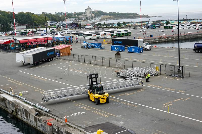 A Hyundai forklift moving dock ramps at a working ship dock in Victoria, Canada. Victoria/Canada-9/14/19: A Hyundai forklift moving dock ramps at a working ship royalty free stock images